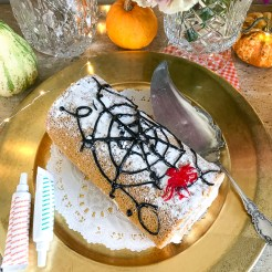 Decorate a pumpkin spice roll with an icing web for that spooky feel