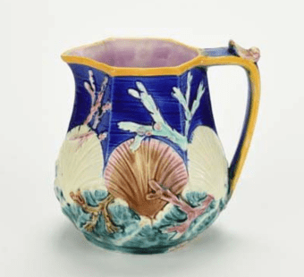 Majolica pitcher with seashells and seaweed.