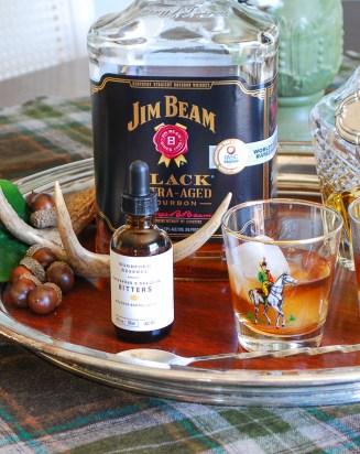 Close up view of Jim Beam Black and sassafras and sorghum bitters