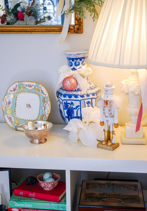 Chinoiserie Christmas with blue and white vase, silver bowl, and nutcracker
