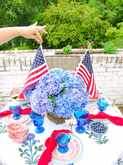 American flag centerpiece with blue hydrangea in wicker vase