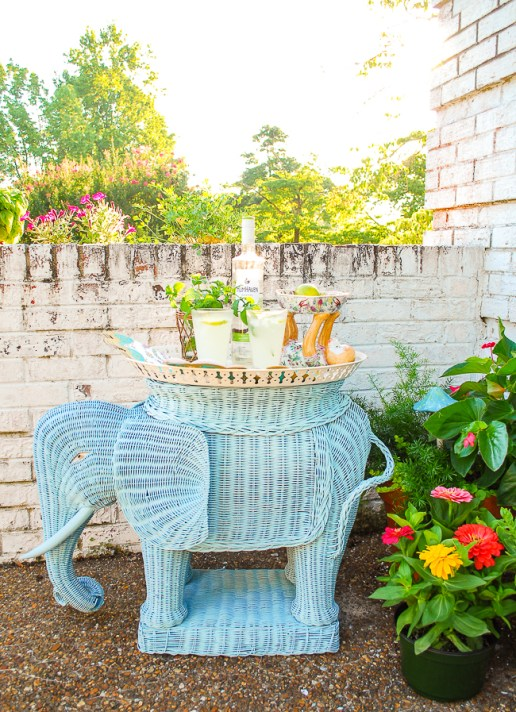 Summer decorating ideas: Vintage wicker elephant stand used as bar for coconut mojitos