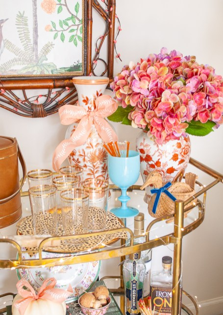 portieux vallerysthal aqua goblet and a collection of coral Chinese floral jars on bar cart