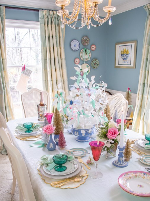 Angle view of dreamy pastel Christmas table dressed up in Jasperware and vintage jewelry