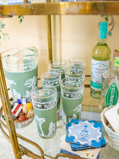 Green Jeanette Jasperware style high ball glasses and pitcher on bar cart