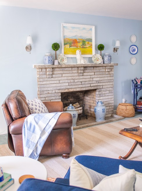 Blue and white family room reveal with new art and Chinoiserie porcelain at fireplace