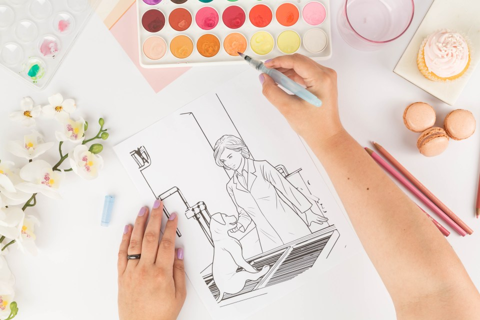 hands coloring with watercolors a Color Joy color page.