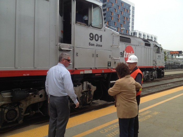Caltrain board member Rose Guilbault prepares to board a locomotive in San Francisco.