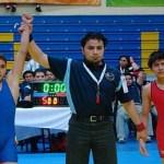 Johan Iván Ruíz Flores decretado triunfador y campeón de la división infantil 44 kilos.