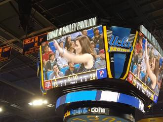 Penn Band on the center scoreboard screen at Pauley Pavilion, photo credit Vicky Sin, C'00