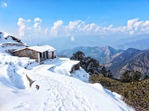Snow covered houses in a village while hiking to Tunganath temple in Chopta, Uttrakhand
