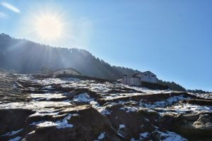 Sun shining over snow in Chopta, Uttrakhand