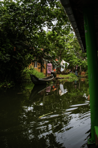 Passing through villages during our canoe tour of backwaters in Alleppey