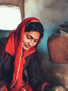 village woman cooking food