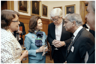 IOA Director, John Q. Trojanowski, MD, PhD, and others chatting with Her Majesty Queen Silvia of Sweden.