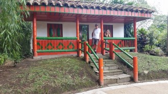 An example of a typical Finca (small farm) home in Colombia. Bright colors, porches and balconies.