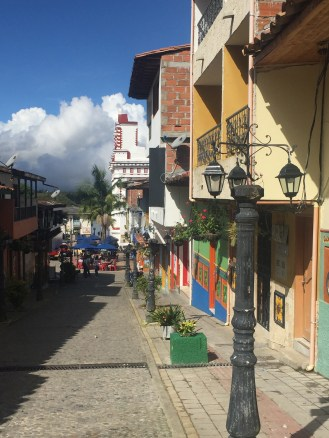 Colorful house and storefronts line the streets of Guatapé