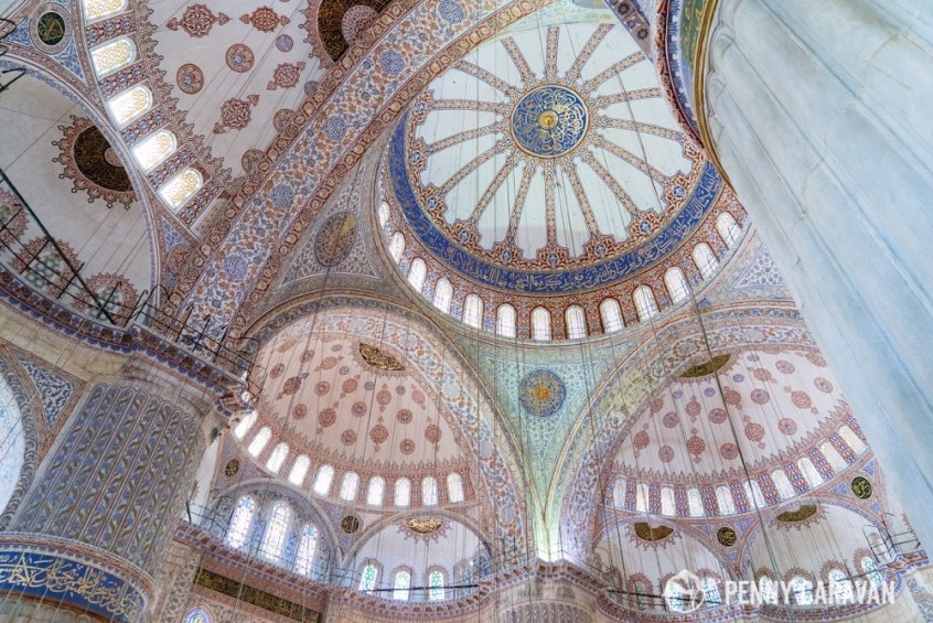 """The blue tiled interior of the Sultan Ahmet Mosque gives it the nickname """"Blue Mosque""""."""