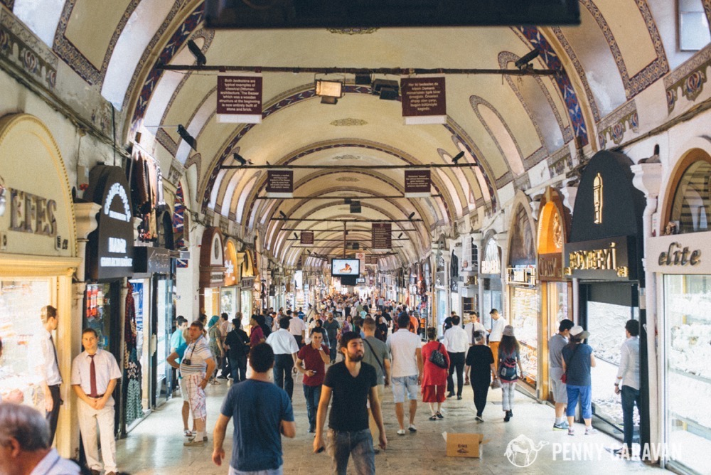One of the main entrances to the grand bazaar. The brown signs hanging from the ceiling give interesting tidbits about the history of the Bazaar.
