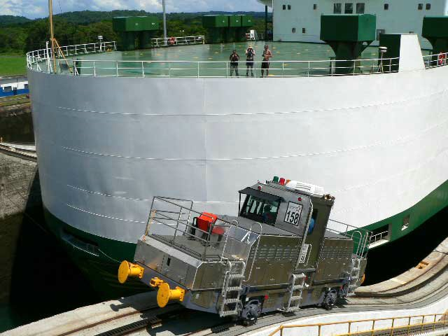 Modern locomotive guiding car carrier through the locks