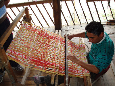 Weaving loom....one string at a time!