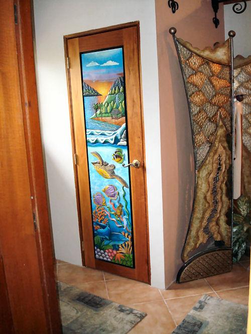 Hand carved door to Social Bath