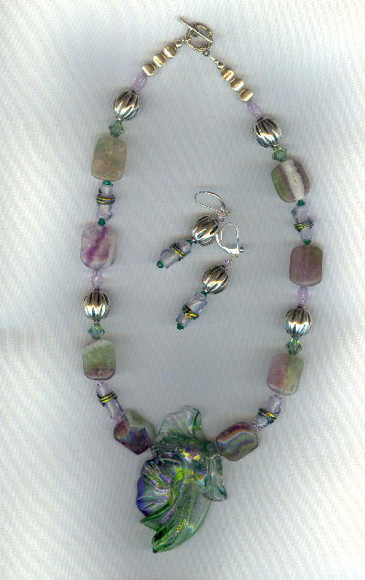 The beautiful Lola bead in the center is hand blown glass