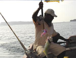 Pedro, our boat captain, catches fish for dinner in the waters off Contadora Island