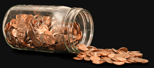 Spilled jar of pennies