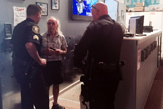 San Joaquin County Sheriff's deputies talk with Bill Dause, the owner of the Lodi Parachute Center.
