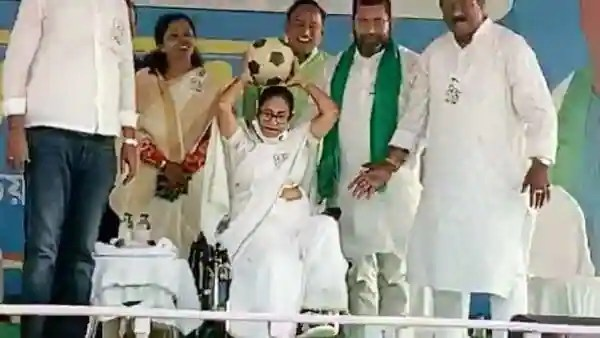 West Bengal Chief Minister Mamata Banerjee passes football towards the crowd during an election rally ahead of the State Assembly election, in Howrah on Wednesday. (ANI Photo)