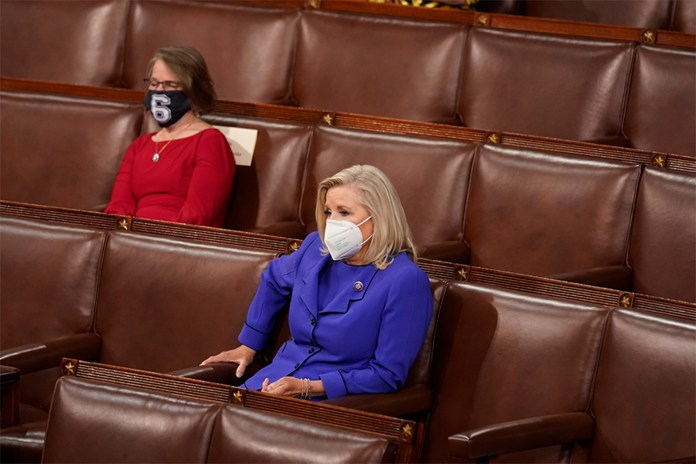 Rep. Liz Cheney listens to President Joe Biden during his first joint congressional address on April 28, 2021.