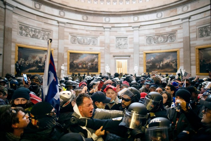 Rioters clash with security forces inside the Capitol building during the siege on January 6, 2021.