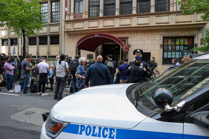Press members gather in front of former President Donald Trump's personal attorney and the former mayor of New York City Rudy Giuliani's apartment after FBI has executed a search warrant of the home.