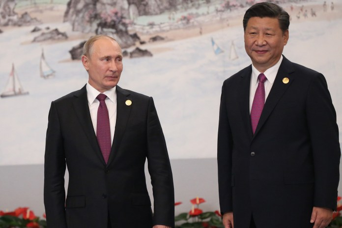 Russian President Vladimir Putin with Chinese President Xi Jinping during a welcoming ceremony prior to the dinner on September 4, 2017 in Xiamen, China.