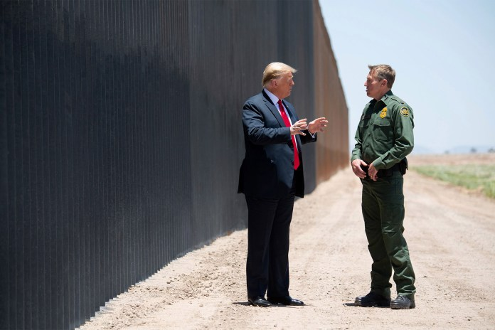 Border Patrol Chief Rodney Scott speaking with former President Donald Trump during a trip to the border.