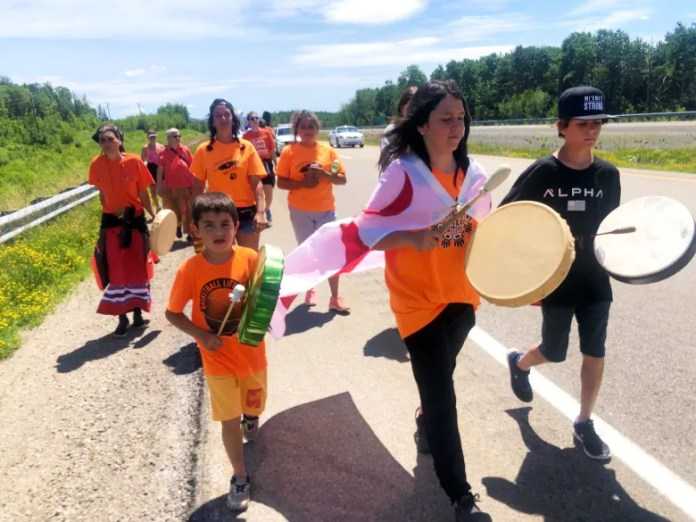 Turning 'anger into something good,' this Mi'kmaw boy is walking 200 km for residential school survivors