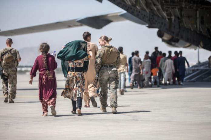 US troops helping Afghan families evacuate the country at Hamid Karzai International Airport in Kabul on August 24, 2021.