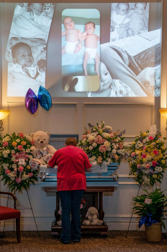 Family and friends gather during a visitation for 7-month-old twins, Ryan and Rileigh Rigney, in Nashville, Tenn. on August 25, 2021.