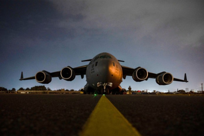 An Air Force C-17 Globemaster III aircrew prepares to receive soldiers. The evacuation from Hamid Karzai International Airport ended before August 31st.