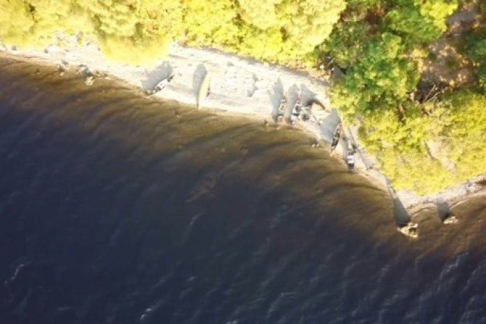 A wild camper believes he has found evidence of the existence of the Loch Ness monster after capturing a massive presence in the murky waters in drone footage.