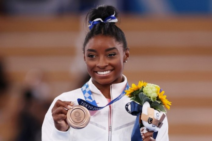 Simone Biles of Team United States poses with the bronze medal during the Women's Balance Beam Final medal ceremony on day eleven of the Tokyo 2020 Olympic Games at Ariake Gymnastics Centre on August 03, 2021 in Tokyo, Japan.