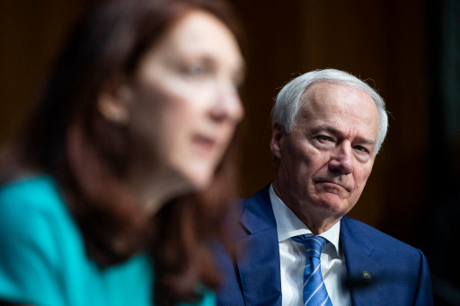 Arkansas Gov. Asa Hutchinson (right) has said that because President Joe Biden has now mandated the COVID-19 vaccine, there is stronger resistance to it.