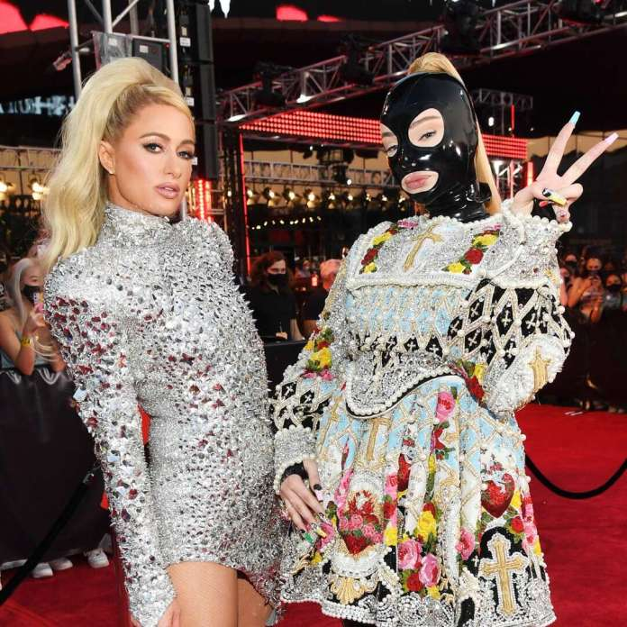 Kim Petras Arrives in Latex Face Mask to MTV VMAs—With VIP Chauffeur