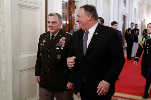Joint Chiefs Chairman Gen. Mark Milley, left, and Secretary of State Mike Pompeo arrive for a Presidential Medal of Freedom ceremony with President Donald Trump and former Vice Chief of Staff of the Army Gen. Jack Keane in the East Room of the White House in Washington, Tuesday, March 10, 2020.