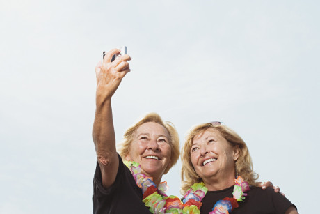 Women taking a picture of themselves --- Image by © Royalty-Free/Corbis