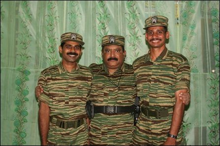 LTTE leader Velupillai Pirapaharan with Tamileelam Air Force (TAF) Black Tiger pilots Col. Rooban and Lt. Col. Siriththiran [Photo: LTTE]