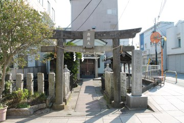 A shrine in the middle of the city.