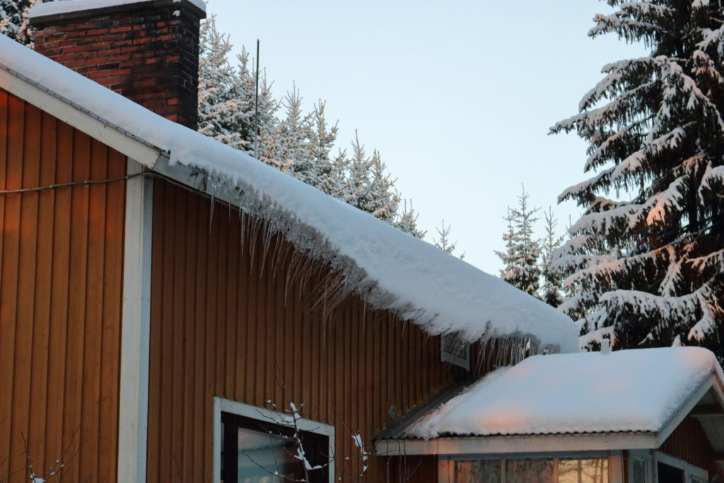 Icicles facing towards the house from the edge of its roof