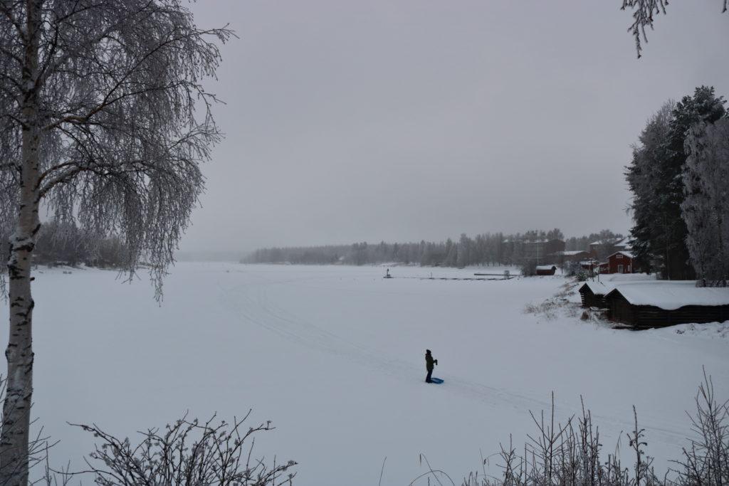 A parent on a frozen lake
